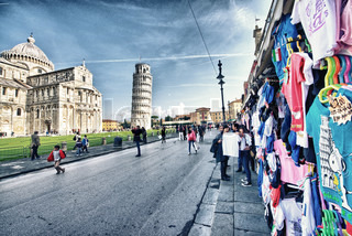 PISA, ITALY - NOV 24: Tourists walk in Miracles Square, November 24, 2012 in Pisa, Italy More than 15 million tourists visit the city each year