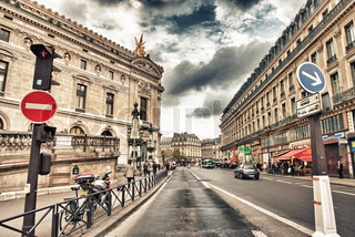 PARIS - NOV 27: Tourists walk along city streets, November 27, 2012 in Paris French capital has almost 50 million visitors every year