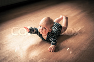 Baby boy exercising on a floor