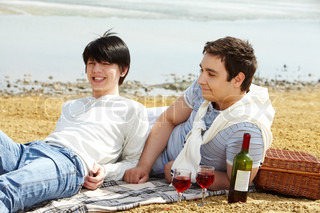 Homosexual Couple Enjoying Themselves Having A Picnic At