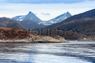 Spring Norwegian landscape with sea and mountains