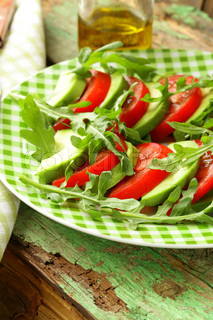 avocado salad with arugula, tomato and olive oil