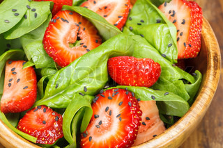 Strawberry Spinach Salad with Poppy seed and sesame dressing. Close up