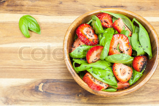 Strawberry Spinach Salad with Poppy seed and sesame dressing. Viewed from above. Copy space