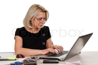 Mature business woman working in the office isolated