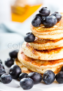 Delicious stack of US pancakes with fresh blueberries