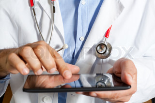 Doctor with tablet