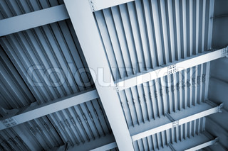 Abstract blue steel construction with beams and bolts junctions