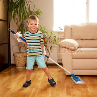 Little Boy Cleaning The Apartment Washing The Floor With