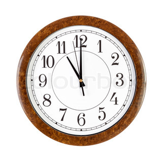 Clock face showing eleven o'clock