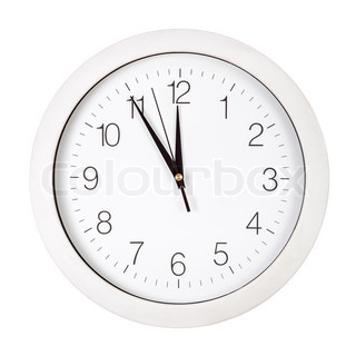 Clock face showing five minutes to twelve