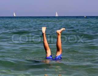 Active boy swimming in the sea water