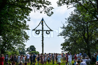 Dancing around the may pole, a swedish tradition at midsummer at the end of june.