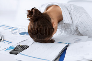 woman sleeping at work in funny pose