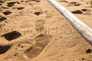 Step Traces of shoes on Sand beach sea-side