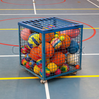 Collection of different balls in a metal cage