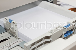 stack of paper in copy machine