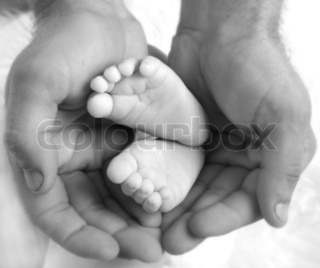 Baby's feet in daddy's hands