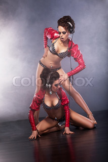 Clubbing Burlesque Playful Funny Showgirls with Headphones in Clubwear