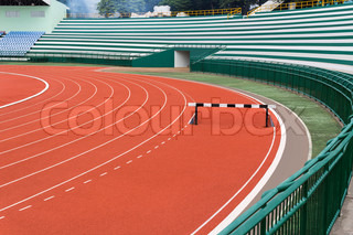 Hurdle on red running track