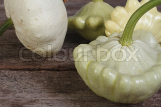 Ripe pattypan squash on a wooden old table