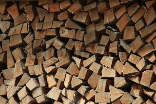 Stacked firewood for the fireplace in the neighbourhood of the cottage in Austria in the summer.