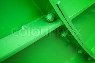 Green abstract industrial background with bolts and metal construction