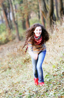 Beautiful young girl on background of the park