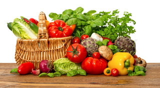 fresh vegetables and herbs on white background