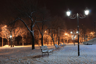 row of lanterns in park at winter