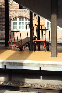 Two empty luggage cars at central railway station