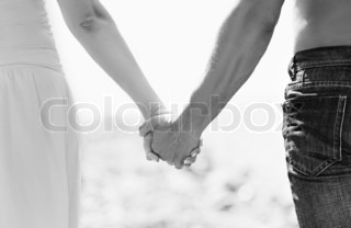 concept of love and family the hands of lovers, men and women in monochrome