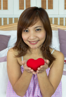 Women happiness with heart shape in hands