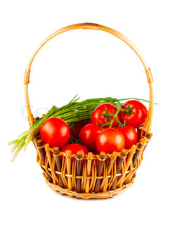 Wicker basket with tomato and green onion