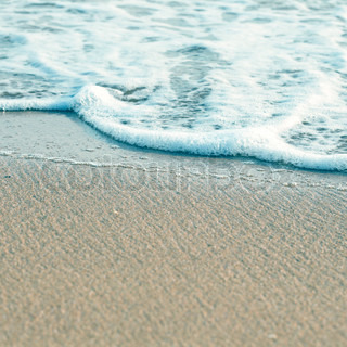 Soft wave of the sea on the sandy beach in art emotion