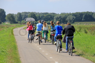 School's out, boyfriends and girlfriends are biking on the cycle path and going home in spring, nice ride.