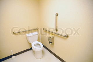 ada clean public toilet with grab bars for handicapped