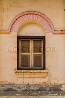 Vintage windows on old brick wall