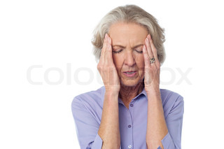 Aged woman holding head due to severe headache