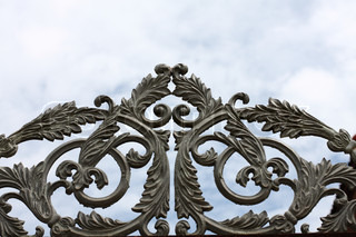 wrought iron gate on blue sky