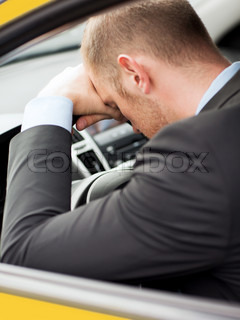 transportation and vehicle concept - tired businessman or taxi car driver