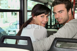 Couple riding the bus together