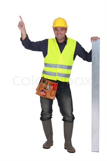 Construction worker pointing at empty copyspace