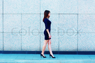 Young attractive businesswoman walking