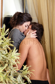 Pashionate photo of a kissing young couple