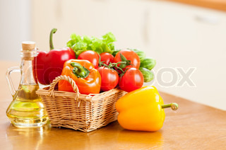 Kitchen Table With Food Cutting Tomato And Preparing Slice Of