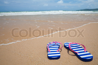 a35c76d9fa37f ... Young girl legs in colorful flipflop sandals on sea beach. Colorful  flipflop footware on sea beach Holiday concept ...