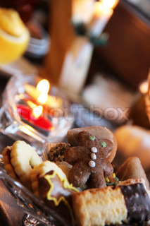 Beautiful Christmas cookies and candles on the table