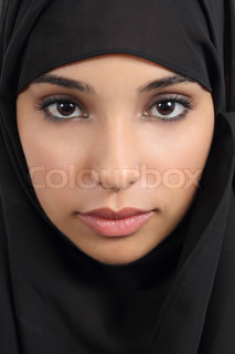Portrait of a beautiful arab woman face with a black scarf