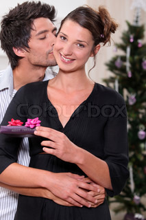 young man kissing his fiancee